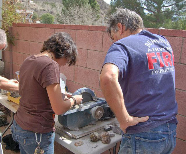 "Bill overseeing Olivia on the 10"" saw."