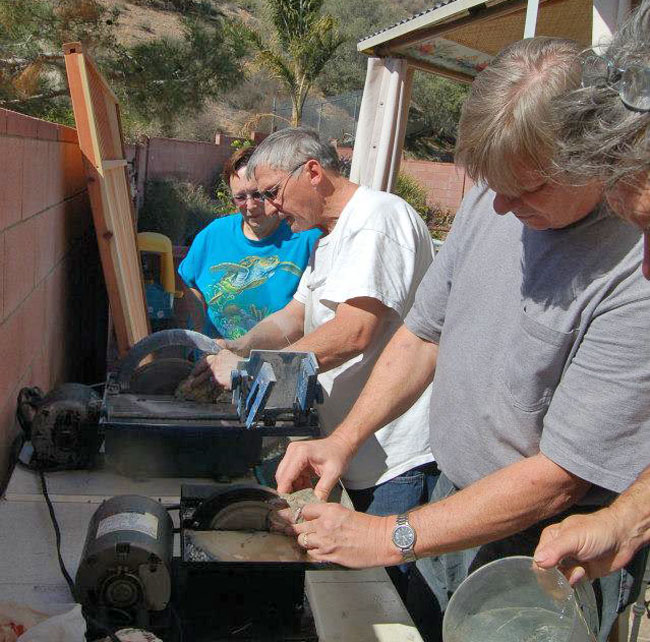 "Dave and Deb using the 10"" saw. Larry learning how to use the 6"" saw."